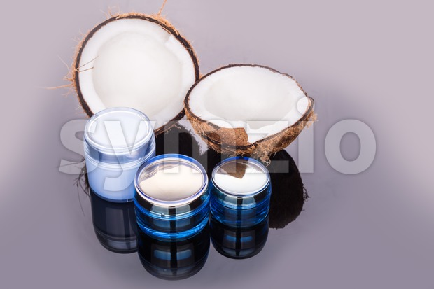 Tubs containing coconut oil are used as moisturizer for skin Stock Photo