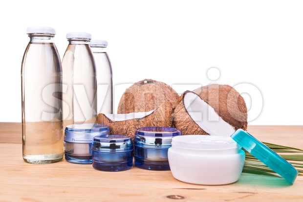 Cold pressed extra virgin coconut oil in bottles and jar Stock Photo
