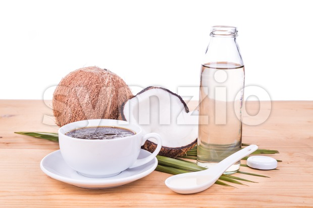 Bulletproof coffee with virgin coconut oil on wooden table Stock Photo