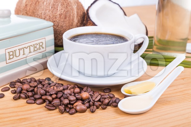 Bulletproof coffee with virgin coconut oil and organic butter Stock Photo
