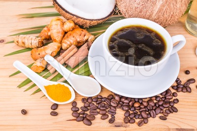 Bulletproof coffee blended with virgin coconut oil, turmeric, clove, herbs Stock Photo