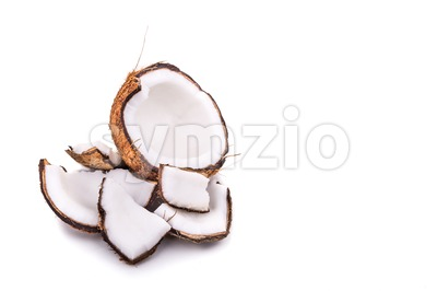 Old brown organic coconut fruit broken into pieces Stock Photo