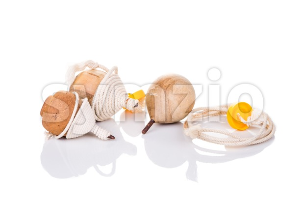 Traditional spin top toy isolated in white background Stock Photo