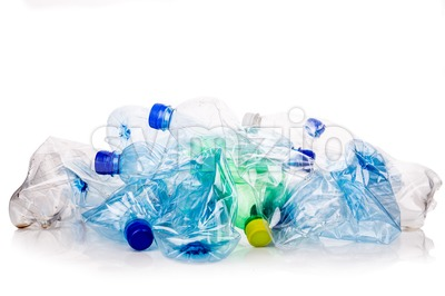 Mineral water bottles crushed and crumpled against white background Stock Photo