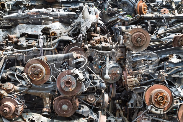 Heaps of used old auto disk and drum brake parts Stock Photo