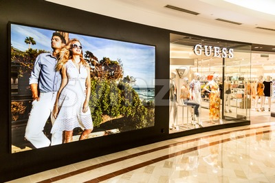 KUALA LUMPUR, MALAYSIA, May 20, 2016: Guess outlet at KLCC Shopping Mall, Kuala Lumpur.  Guess is an American upscale clothing line brand popular with Stock Photo