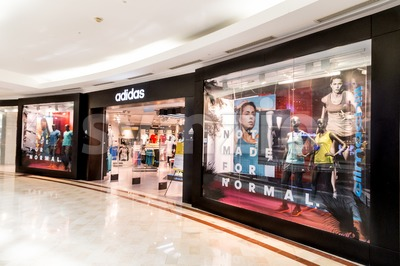 KUALA LUMPUR, MALAYSIA, May 20, 2016: Adidas outlet at KLCC, Kuala Lumpur.  Adidas, a multinational corporation founded in 1948 in Germany, is one of Stock Photo