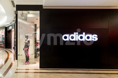 KUALA LUMPUR, MALAYSIA, May 20, 2016: Adidas signage on its outlet at KLCC, Kuala Lumpur.  Adidas was founded in 1948 in Germany, is one of the Stock Photo