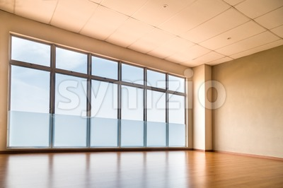 Perspective view of empty studio illuminated with light from windows Stock Photo