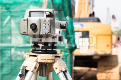 Dumpy automatic level instrument with construction site background Stock Photo