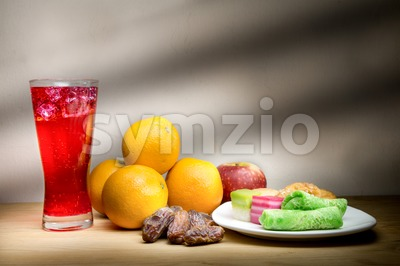 Cold drinks, dates, sweet kuih common iftar break fast food. Stock Photo