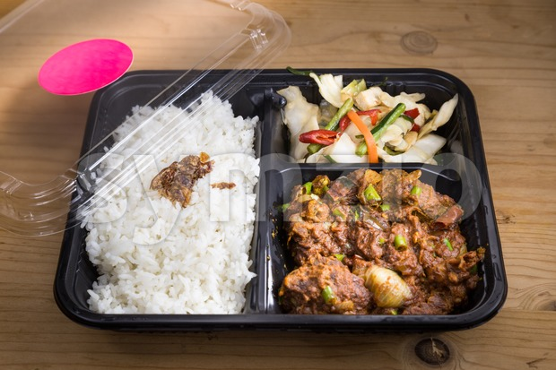 Convenient take-away meal box with rice, meat and vegetable Stock Photo