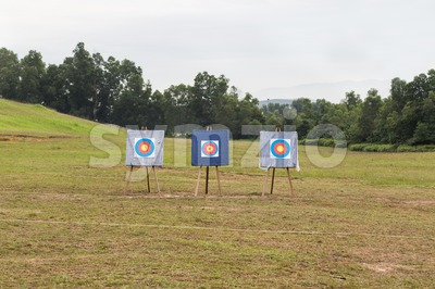 Outdoor archery target range with three target boards Stock Photo