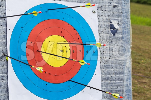 Closeup on outdoor archery target board with arrows Stock Photo