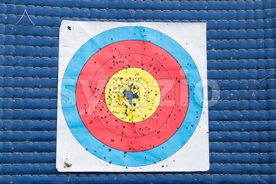 Closeup on used and worn out outdoor archery target board Stock Photo