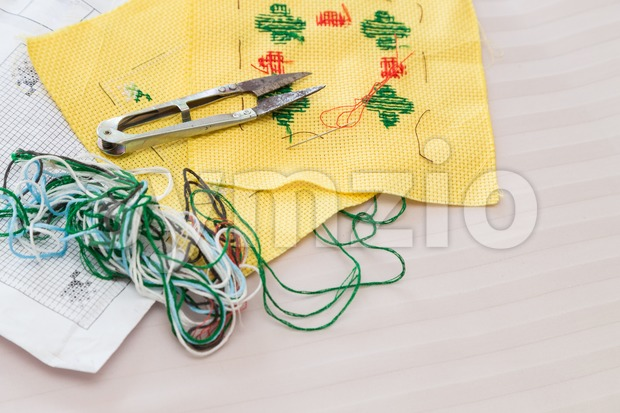 Cross stitch kit of fabric, needle, thread, scissor and chart Stock Photo