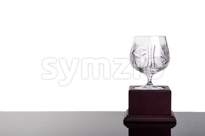 Elegant crystal cup trophy on white background flushed right Stock Photo