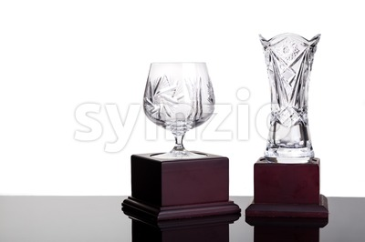 Elegant crystal cup and vase trophies on white background Stock Photo