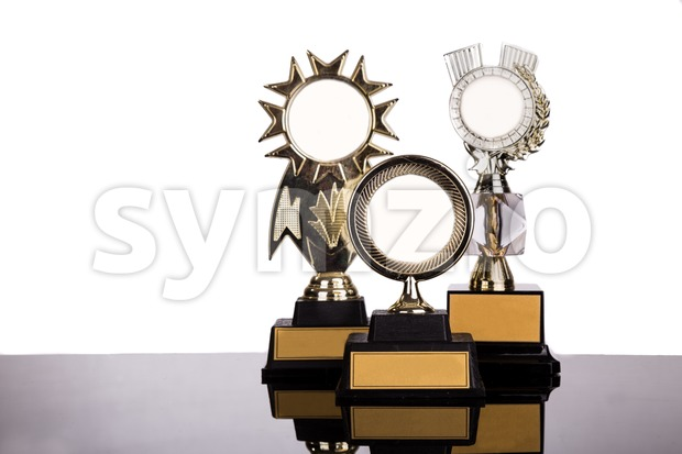 Group of gold medal trophy with space for text on white background