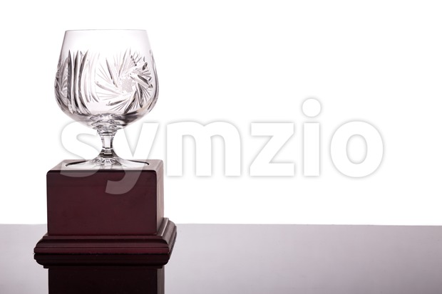 Elegant crystal cup trophy on white background flushed left Stock Photo