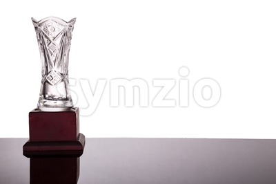 Elegant crystal vase trophy on white background flushed left Stock Photo