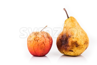 Rotten and decomposing red apple and pear on white background Stock Photo