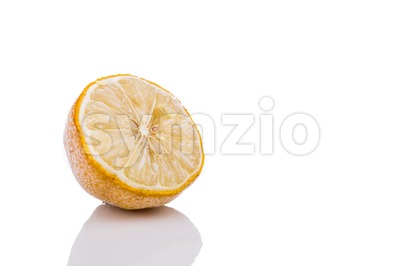 Frozen lemon isolated in white background Stock Photo