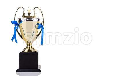 Gold trophy with blue decorative ribbons on white background Stock Photo