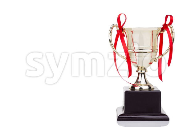 Gold trophy with red decorative ribbons on white background Stock Photo