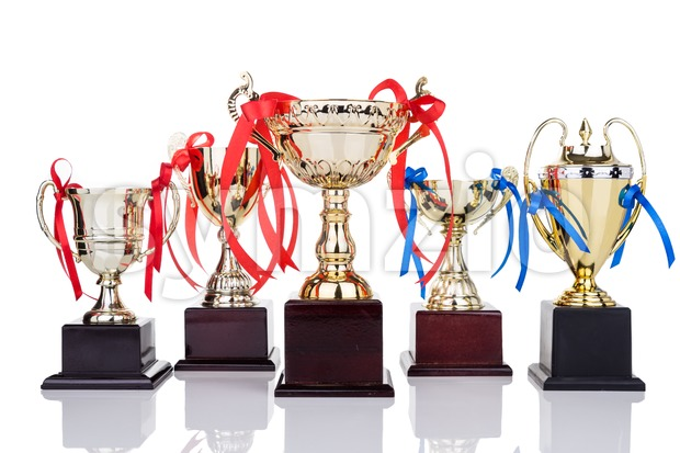 Gold trophies with decorative ribbons on white background Stock Photo