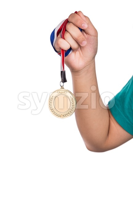 Athlete holding gold medal with ribbon with his hand Stock Photo
