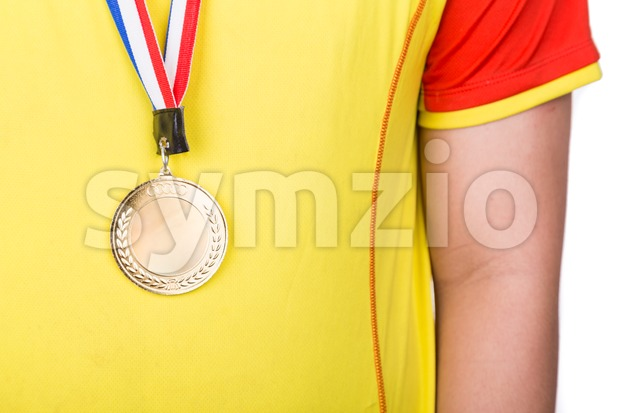 Athlete wearing generic gold medal with ribbon on his neck Stock Photo