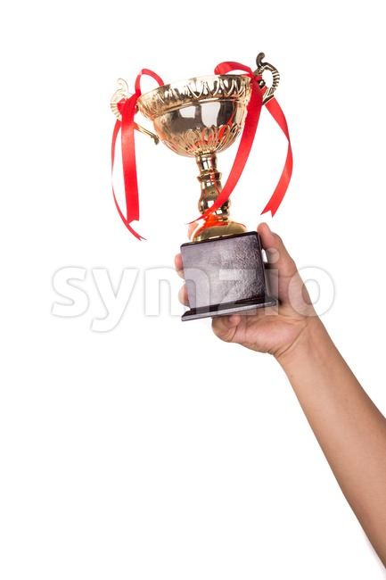 Athlete lifting up gold trophy with one hand Stock Photo