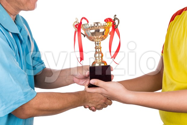 Athlete receiving gold trophy during prize presentation ceremony Stock Photo