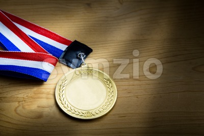 Generic sporting event gold medal with red and blue ribbon Stock Photo