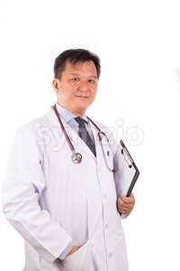 Matured, confident Asian male medical doctor with stetescope, white coat Stock Photo