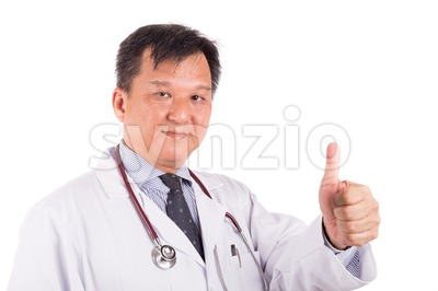 Matured Asian male medical doctor displays thumb up Stock Photo