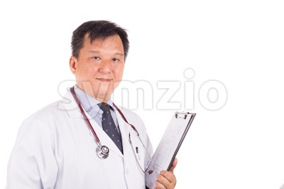 Matured, confident Asian male medical doctor with stethoscope, white coat Stock Photo
