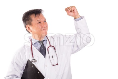 Successful matured Asian medical doctor rejoicing with raised hand Stock Photo