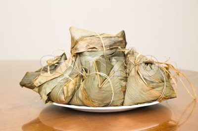 Traditional Duanwu Chinese rice dumplings stacked on plate Stock Photo