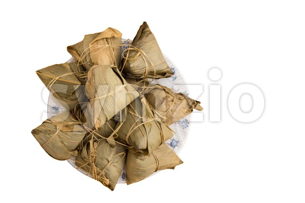 Bunch of traditional Duanwu Chinese rice dumplings isolated on white Stock Photo