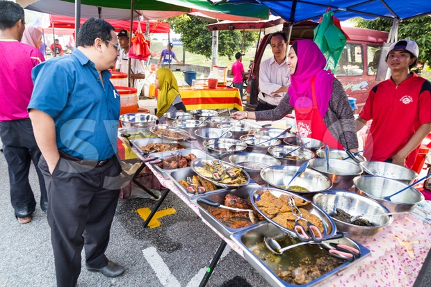 KUALA LUMPUR, MALAYSIA, June 7, 2016:  FIrst day of Ramadan with food vendors at street bazaar selling delicacies catered ...