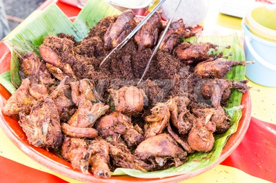 Fried chicken with spice, popular at food bazaar during Ramadan. Stock Photo