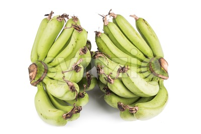 Two bunches of sweet organic green banana on white background Stock Photo