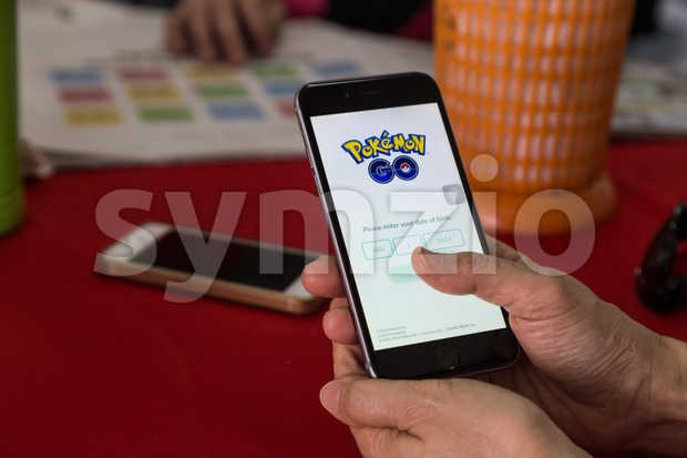 KUALA LUMPUR, MALAYSIA, JULY 16, 2016: An IOS user prepares to register Pokemon Go, a free-to-play augmented reality mobile game developed by Niantic Stock Photo