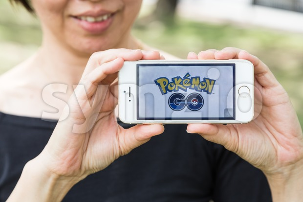 KUALA LUMPUR, MALAYSIA, JULY 24, 2016: An IOS user plays Pokemon Go, a free-to-play augmented reality mobile game developed by Niantic for iOS and Stock Photo