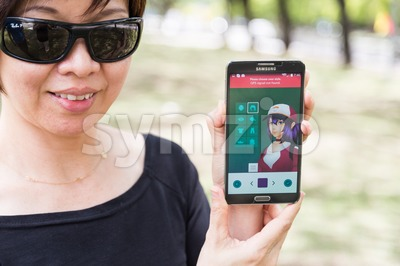 KUALA LUMPUR, MALAYSIA, JULY 24, 2016: An Android user plays Pokemon Go, a free-to-play augmented reality mobile game developed by Niantic for iOS and Stock Photo