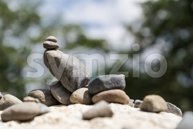 Closeup of Zen rock arrangement with nature background Stock Photo