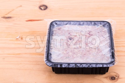 Convenient packaged minced raw meat dog food in sealed tub Stock Photo