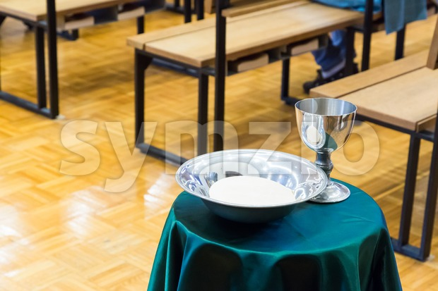 Catholic bread and wine in silver chalice Stock Photo
